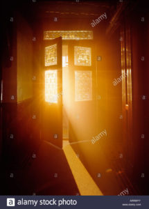 A picture of open french doors with light spilling through